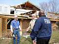 FEMA - 34425 - FEMA and SBA workers speak with a resident in Kentucky.jpg