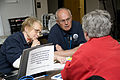 FEMA - 40778 - FEMA mitigation specialists talk to a resident at the Fargo Disaster Recovery Center (DRC).jpg
