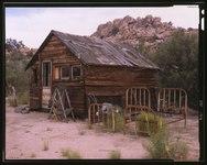 FRONT AND SIDE ELEVATION LOOKING NORTHWEST - Desert Queen Ranch, Guest House, Twentynine Palms, San Bernardino County, CA HABS CAL,36-TNPAL.V,1C-7 (CT).tif