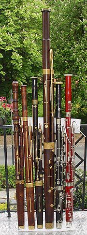 A collection of historical bassoons, from early baroque to modern, including a classical contrabassoon.