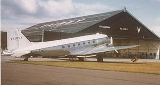 Fairey Aviation Company - Fairey Air Surveys Douglas DC-3 outside Fairey's 1937-built hangar at Manchester Airport during servicing in 1975