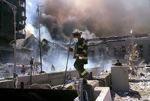 Fire fighters amid smoking rubble after September 11th terrorist attack (29392249476)