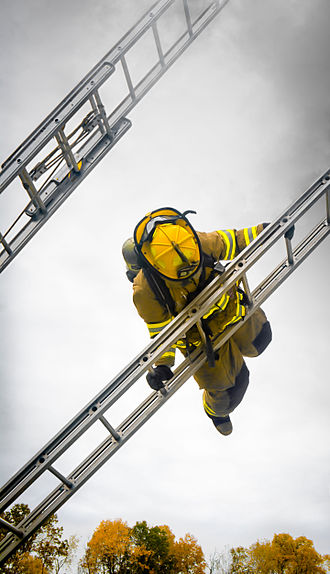 Firefighter - Firefighter carrying out a ladder slide