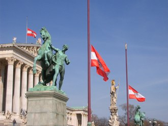 Half-mast - The Austrian flag flying at half-mast before the Austrian Parliament Building, due to the death of President Thomas Klestil, on July 7, 2004