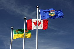 The flags of Saskatchewan and Alberta flanking the flag of Canada in Lloydminster