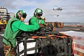 Flickr - Official U.S. Navy Imagery - Sailors remove a cargo net from delivered supplies on the flight deck.jpg