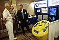 Flickr - Official U.S. Navy Imagery - The Chief of Naval Research talks with the vice president of engineering at Mikros Systems Corporation, about their energy harvesting microbuoy during the 2012 Navy Opportunity Forum..jpg