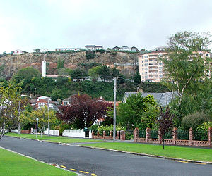 St Clair, New Zealand - The Frances Hodgkins Retirement Village and the spire of Dunedin's LDS Church meetinghouse are visible against the cliffs of the former quarry that lies to the west of Forbury Road.