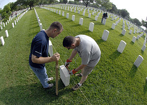 Fort Sam Houston National Cemetery - A crew works to straighten grave stones at Fort Sam Houston National Cemetery.