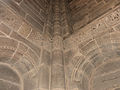 Fr Moselle Hesse Abbey church Romanesque relief Corner with the monstrous birds face.jpg