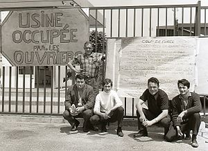 "Protests of 1968 - Strikers in Southern France with a sign reading ""Factory Occupied by the Workers."" Behind them is a list of demands"