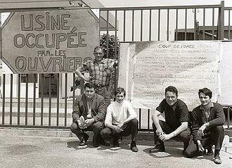 "May 1968 events in France - Strikers in Southern France with a sign reading ""Factory Occupied by the Workers."" Behind them is a list of demands, June 1968."