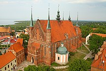 Lidzbark Castle (on the left) was the main seat of the Prince-Bishops of Warmia, and Frombork Cathedral (on the right) was the bishopric's cathedral. Both objects are considered the most precious historic heritage sites of Warmia, and are listed as Historic Monuments of Poland.[13][14]