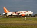 G-EZIM easyJet Airbus A319-111 landing at Schiphol (EHAM-AMS) runway 18R pic2.JPG