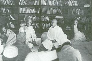 Congress Working Committee - Mahatma Gandhi attends a Congress Working Committee meeting at Anand Bhavan, Allahabad; Vallabhbhai Patel to the left, Vijaya Lakshmi Pandit to the right, January 1940.