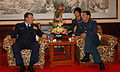 Gen. Paul V. Hester discusses military-to-military engagement with Chinese Gen. Ge Zhenfeng.jpg