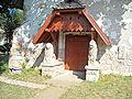 Geoagiu reformed church with lions.jpg
