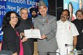 Ghulam Nabi Azad presenting the certificate to the Additional Secretary, Department of AIDS Control, Smt. Aradhana Johri, at the closing function of Red Ribbon Express-III, in New Delhi. The Union Minister for Railways.jpg