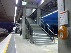 Glenfield, New South Wales - Recently upgraded platforms 1 and 2 of Glenfield station, with stairways leading to an overhead concourse.