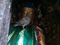 God of Peace (Buddha) and Symbol of Peace Peagon in Swoyambhunath Temple Kathmandu.jpg