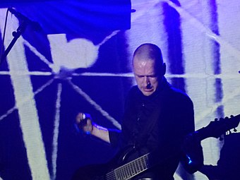 Broadrick performing live with an eight-string guitar on 17 September 2015 Godflesh91715.jpg