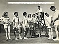 Gordon Harley teaching Roger Skillings and other juniors at Victoria Lawn Tennis Club.jpg