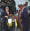 A photo of Reggie White and other Packers players with former president Bill Clinton