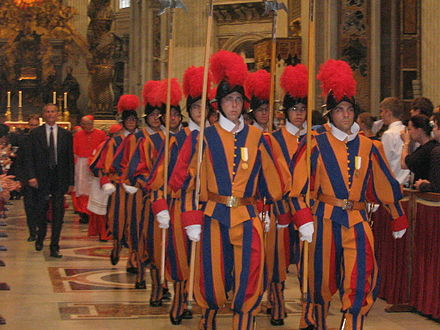 Group of Pontifical Swiss Guard inside St. Peter's Basilica. Group of swiss guards inside saint peter dome.jpg
