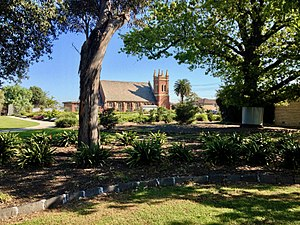 Sunshine, Victoria - The H.V. McKay Memorial Gardens with the Sunshine Presbyterian Church in the background