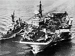 HMS Victorious (R38) refuels USS Walke (DD-723) in the Pacific Ocean, in 1965.jpg