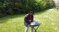 Handpan drum musician Drumkoon using mallets.png