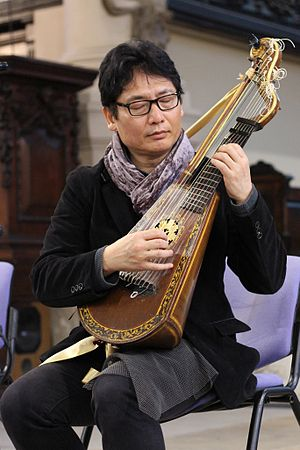 Harp lute - An early 19th century harp lute being played by Taro Takeuchi