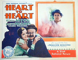 Lucien Littlefield - Lobby card for Heart to Heart (1928) with Littlefield holding Mary Astor