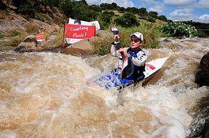 Dusi Canoe Marathon - A paddler shooting Mission Rapid during the Dusi Canoe Marathon