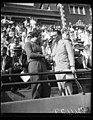 Hoover conversing with speed star, Washington, D.C. Sept. 12. Miss Helen Stephens, 18 year old Olympic champion is shown talking to J. Edgar Hoover, Director of the Federal Bureau of LCCN2016878463.jpg