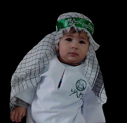 In the Hosseini infancy conference, babies wear green or white clothing like that of Ali al-Asghar ibn Husayn and have a headband with his name on it. Hosseini infancy conference.jpg