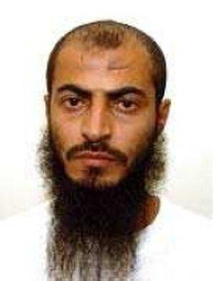 Abdu Ali al Haji Sharqawi - Abdu Ali Sharqawi official Guantanamo portrait, showing him wearing the white uniform issued to compliant captives.