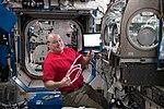 ISS-55 Scott Tingle works inside the Destiny lab.jpg