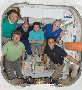 Commercial Resupply Services - ISS crew inside Dragon C2, docked to ISS in 2012