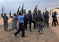 Iraqi police students celebrate passing a building clearing test at a police academy in Basra, Iraq, April 20, 2011 110420-A-YD132-169.jpg