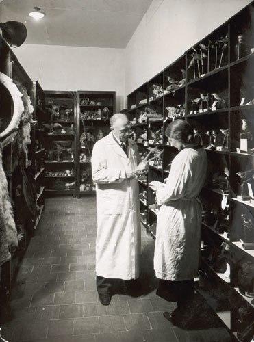Israel Aharoni, holding a Capreolus capreolus skull, standing next to his daughter Bat-Sheva