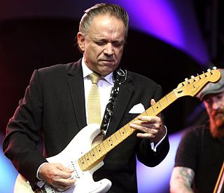 Jimmie Vaughan American blues rock guitarist and singer