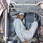 John K. Hirasaki decontaminating Apollo 11 (NASA photo S69-45487).jpg
