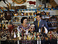 John M. Gonatos in his curio shop viewing shells with assistant Niki Vasilikis in Tarpon Springs, Florida.jpg
