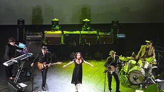 "PJ Harvey - John Parish and Harvey performing live in 2009. Parish – whom Harvey describes as her ""musical soulmate"" – has been working with Harvey for over 20 years."
