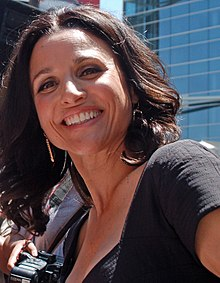 A close-up of Julia Louis-Dreyfus from a worm's eye view
