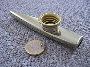 Kazoo - A metal kazoo with a 1 euro coin for comparison: 23.25 mm (0.92 inch)