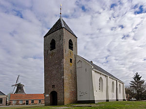 Mensingeweer - Michaelkerk with windmill on the left