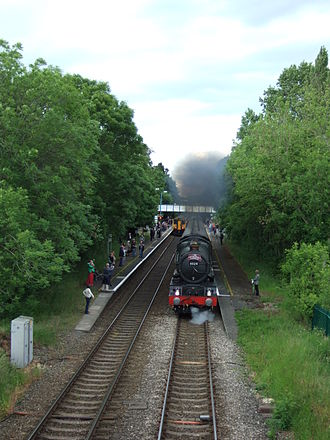 Railways of Shropshire - A steam charter train heads through Church Stretton on the Welsh Marches Line, passing a regular DMU service.