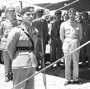 Hussein of Jordan - Hussein addressing his troops in 1956, as Ali Abu Nuwar, the army chief of staff, who in 1957 was involved in an alleged coup attempt, observes.